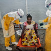 Fatou called an emergency number to call for help. Her sister Marie Finda Kamono, 33 years old, is ill.  She is vomiting, has diarrhoea and is suffering from fatigue: the usual symptoms of Ebola.  A Médecins Sans Frontières (MSF) team comes to pick her up.   Guéckedou, Guinée Forestière à Guinée.  Sylvain CHERKAOUI / Cosmos pour MSF